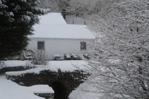 Picture of the Old Mill Foundation building in the snow